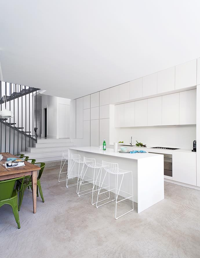 """In family life it's easy for clutter to accumulate and I wanted to avoid this by creating a neutral and understated kitchen,"" Liesel says. The cabinetry and Corian benchtops were made by Jayen Innovations in Brookvale, NSW. The Tio stools are from Spence & Lyda."