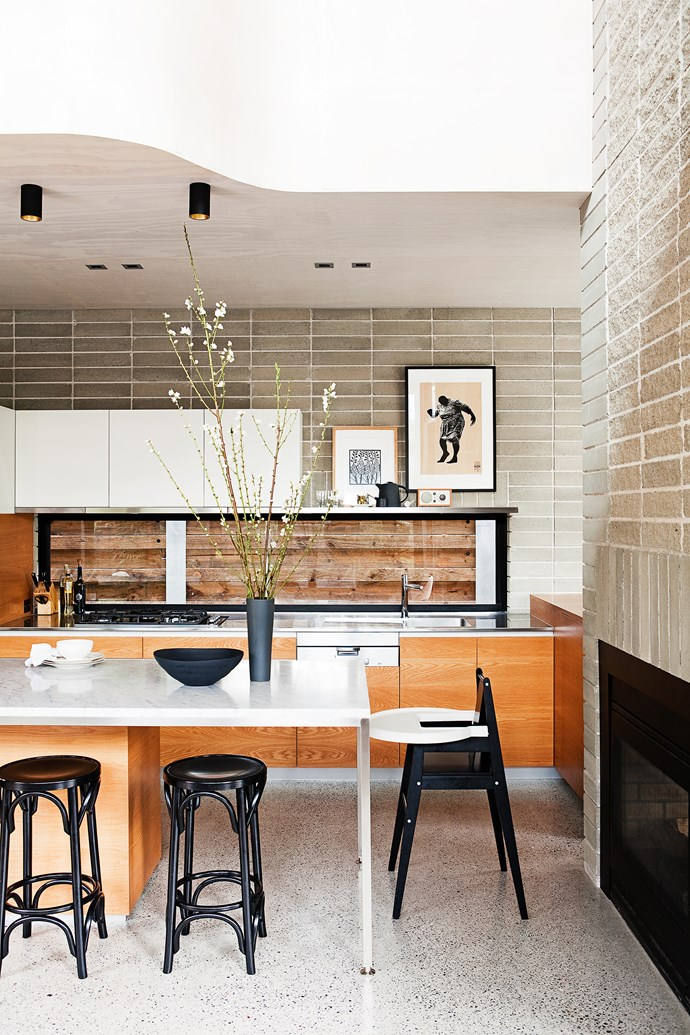 """Rather than overpowering the room with a big island bench, a marble top sits on sleek stainless steel-frame. Take a tour of this [environmentally-conscious new build](http://www.homestolove.com.au/how-to-build-an-eco-friendly-family-home-from-scratch-3490