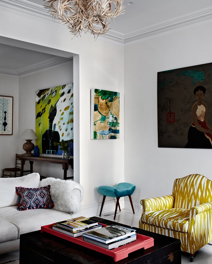 """""""I use white as a canvas, then build colour onto that with art and fabrics. Luigi said it was like someone dropped a paint bomb in here,"""" says Heidi."""