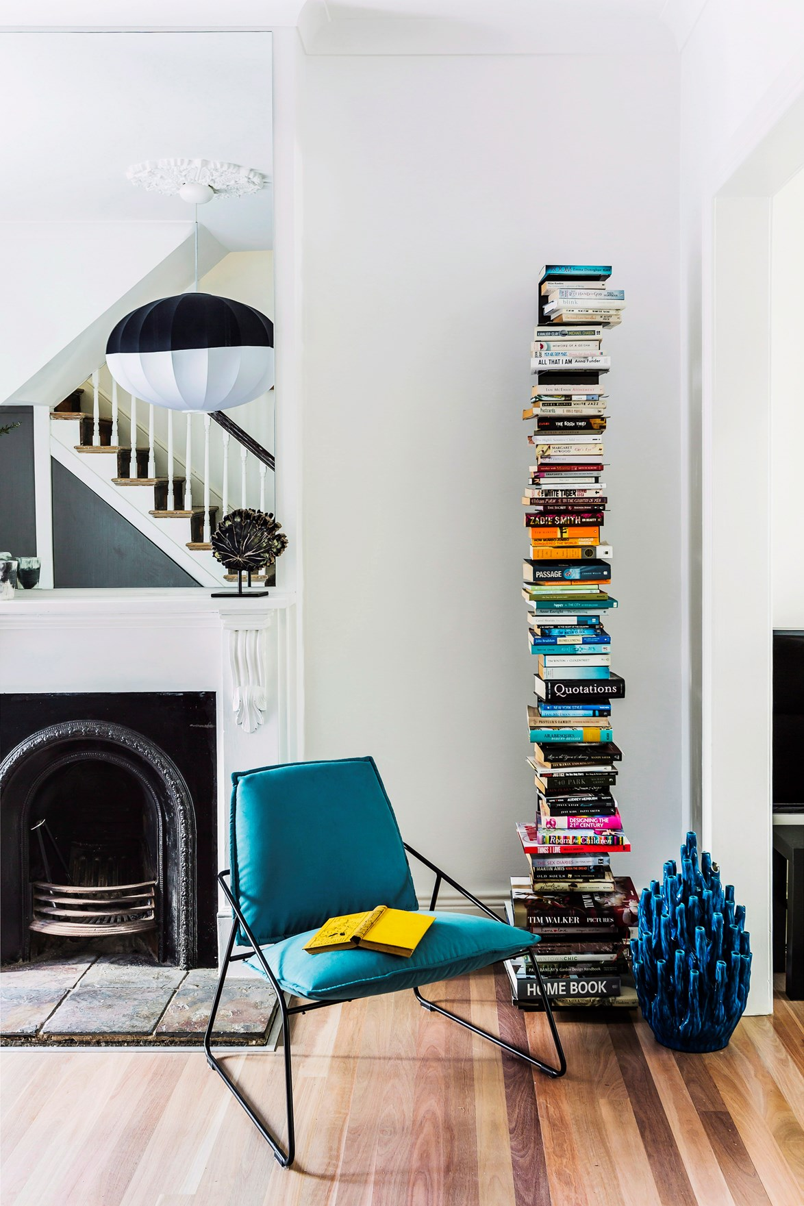 Sometimes, when storage space is a problem, the only way to go is up. This striking vertical bookshelf keeps your books in order while making a style statement. *Photo:* Maree Homer / *bauersyndication.com.au*