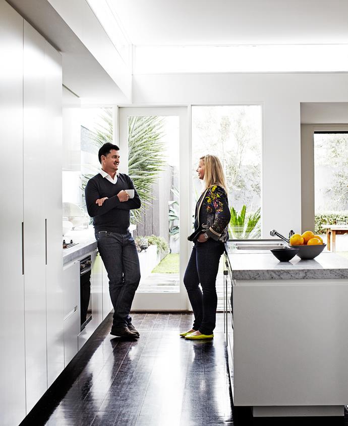 Denis & Eliza chat in their new kitchen.