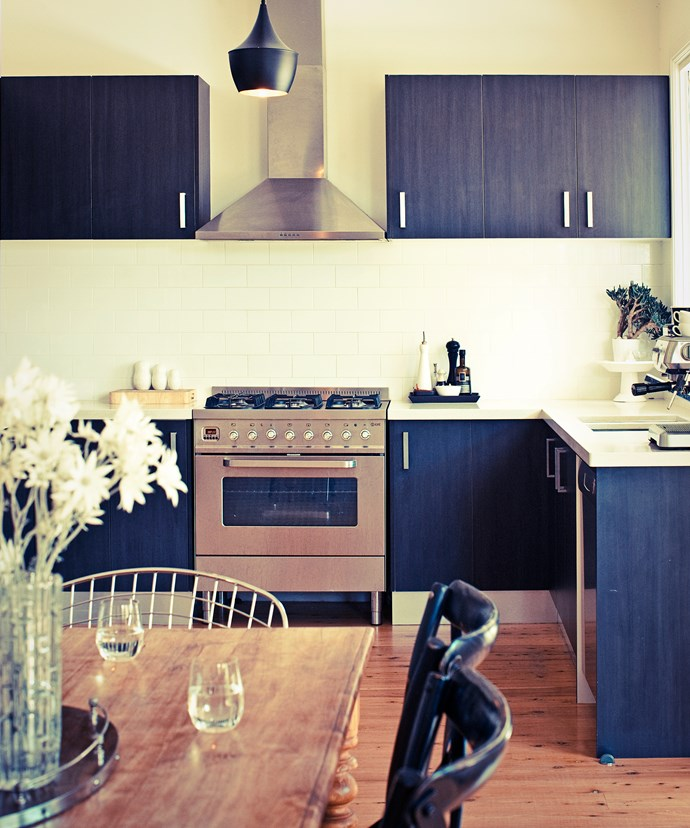 """The mix of subway tiles and dark kitchen cabinetry give the kitchen of [this family-friendly bungalow](http://www.homestolove.com.au/a-family-friendly-bungalow-renovation-3514