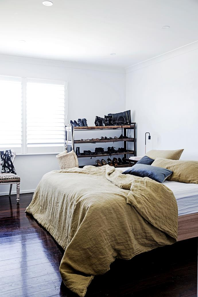 "The couple's bed was custom-made by Elo Silo. The bedding came from [Bodie & Fou](https://www.bodieandfou.com//?utm_campaign=supplier/|target=""_blank""). A vintage baker's rack from Rust in Avalon is used to store Lauren's shoes."