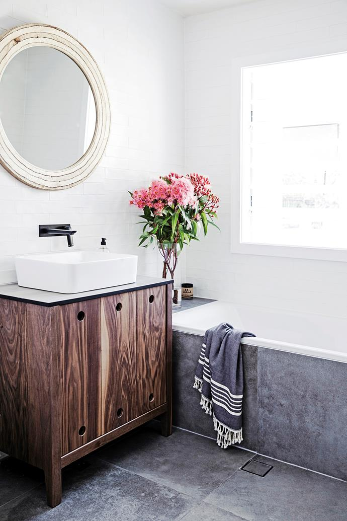 """The bathroom was very low spec and my least favourite space in the house,"" Lauren says. ""We changed the layout so the toilet wasn't the first thing you saw as you entered, and replaced everything, including the window."" The vanity was also custom-made by Elo Silo. The sink is from [Acqua Bathrooms](https://acqua-bathrooms.myshopify.com//?utm_campaign=supplier/