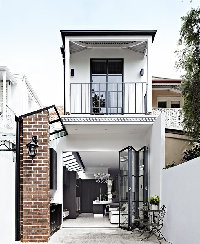 The rear of the 4m-wide terrace − formerly a series of small rooms − now contains an open-plan kitchen/ living area. An outdoor barbecue area was constructed from weatherproof marine ply but stained the same colour as the kitchen.