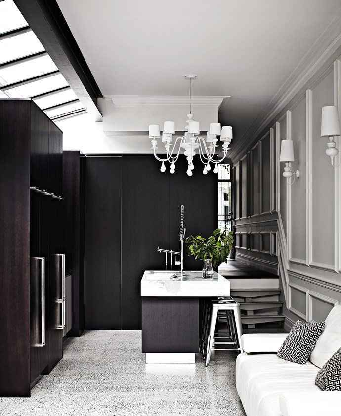 """This sophisticated kitchen is kept sleek with several appliances hidden behind the kitchen cabinetry. Take a tour of this [contemporary terrace home](http://www.homestolove.com.au/contemporary-yet-classic-terrace-revamp-3521