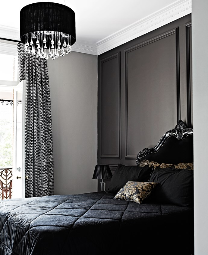 Dark panelled wall injects the space with a classic, moody luxe vibe.