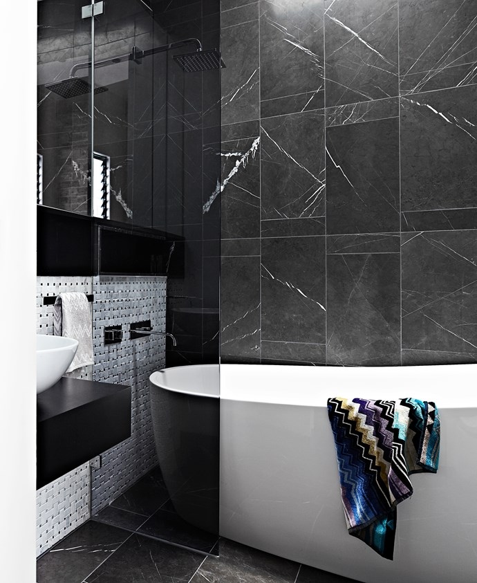 """Lee set his tiler to work in the bathroom, creating a geometric design with Pietra marble tiles from [Nefiko Marble](http://www.nefiko.com/?utm_campaign=supplier/