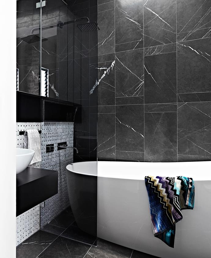 "Lee set his tiler to work in the bathroom, creating a geometric design with Pietra marble tiles from [Nefiko Marble](http://www.nefiko.com/?utm_campaign=supplier/|target=""_blank"")."