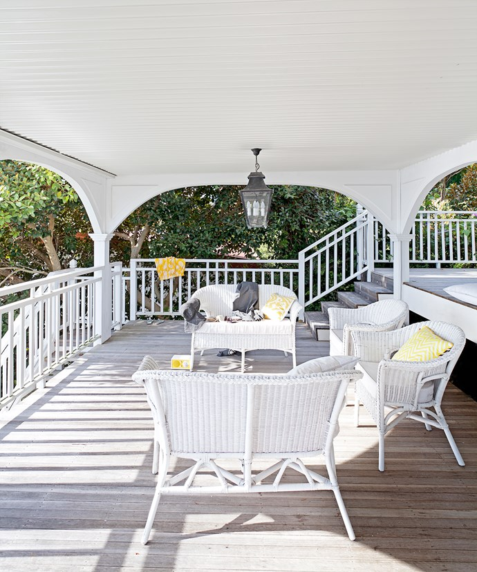 "**Laid-back living.** Wicker has become synonymous with Hamptons style. It is, more often than not, painted white to reflect light and keep the homes looking more beachy than country. This space, sheltered from the elements, is one of the homeowner's favourite spaces. ""We love the tiered deck area, which was our only structural addition, and how much of the house opens seamlessly onto it,"" Jane says."