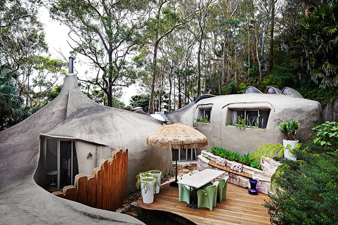 "The unusual house embraces its natural bush environment on Sydney's Northern Beaches. Nancy installed blackbutt decking to make the most of the outside spaces. Driade ""Clover"" chairs by Ron Arad bring a quirky vibe to one of several outdoor zones, as do the Grow (mode) LED light-up plant pots from Mode Solutions."