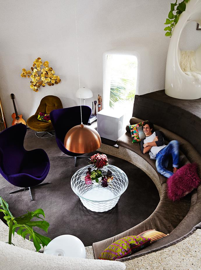 """A circular conversation pit in a [home designed by architect David Hollander](https://www.homestolove.com.au/sydneys-northern-beaches-home-gets-60s-style-makeover-3527