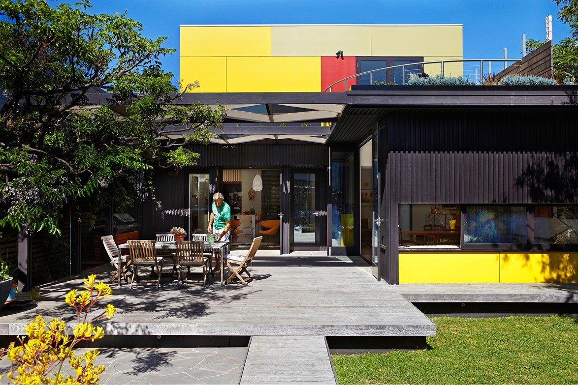 Can you believe this is an Edwardian era home? While the front of the home was carefully restored, the back extension is a celebration of modern design with bold pops of colour. *Photo: Alicia Taylor*