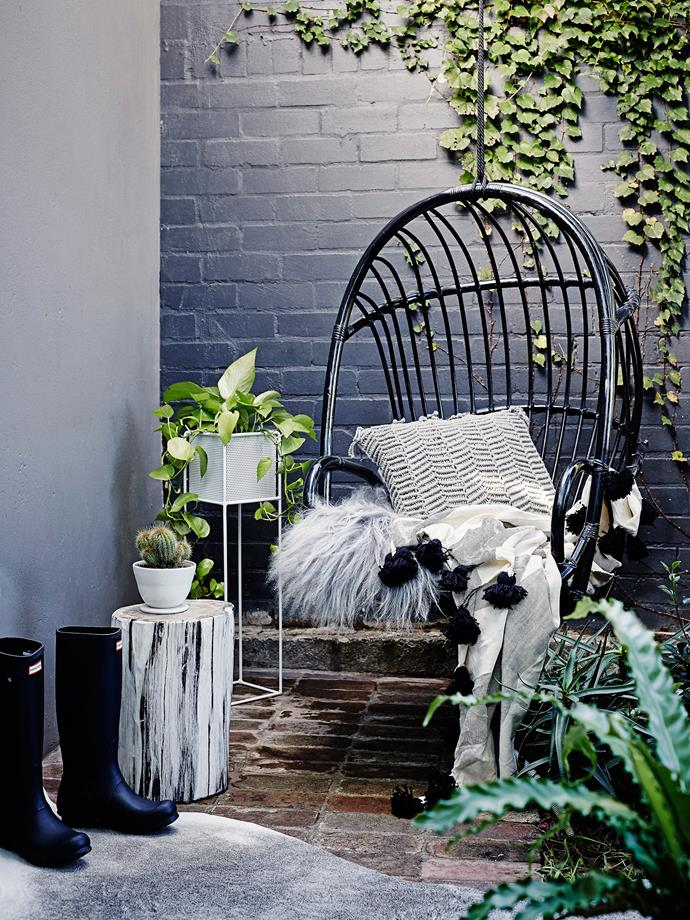 **9. Add winter warmers.** If space on-ground is limited, consider a hanging chair. You can kick off your gumboots and snuggle into warming winter essentials like shaggy blankets, cushions and throws. Photo: Brett Stevens / Bauersyndication.com.au.