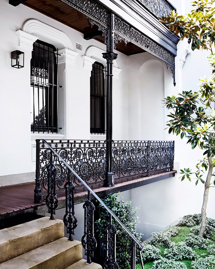 The exterior of the c1880s four-level home with its decorative mouldings and fretwork.