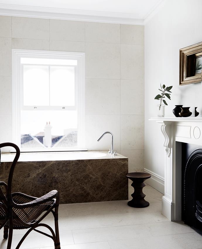 Slick new bathrooms boast milky limestone and tan marble.