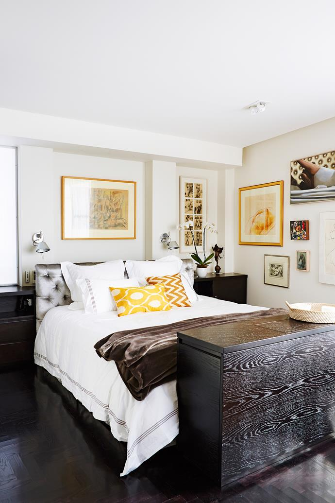 """While the walls are all high drama, the materials and colour palette of this apartment set up a relaxing ambience for work and relaxation. """"The owners love that it's low-maintenance and a showcase for their art,"""" says Alex."""