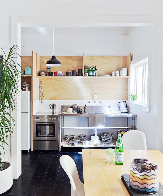 "Open kitchen shelves, designed by Sam's friend and architect, Kelvin Ho, are made from plywood bought from Bunnings. The colour and grain lend a warm, characterful vibe to the kitchen. ""The ply has a light gloss on it that's been sanded back lightly,"" Sam says."
