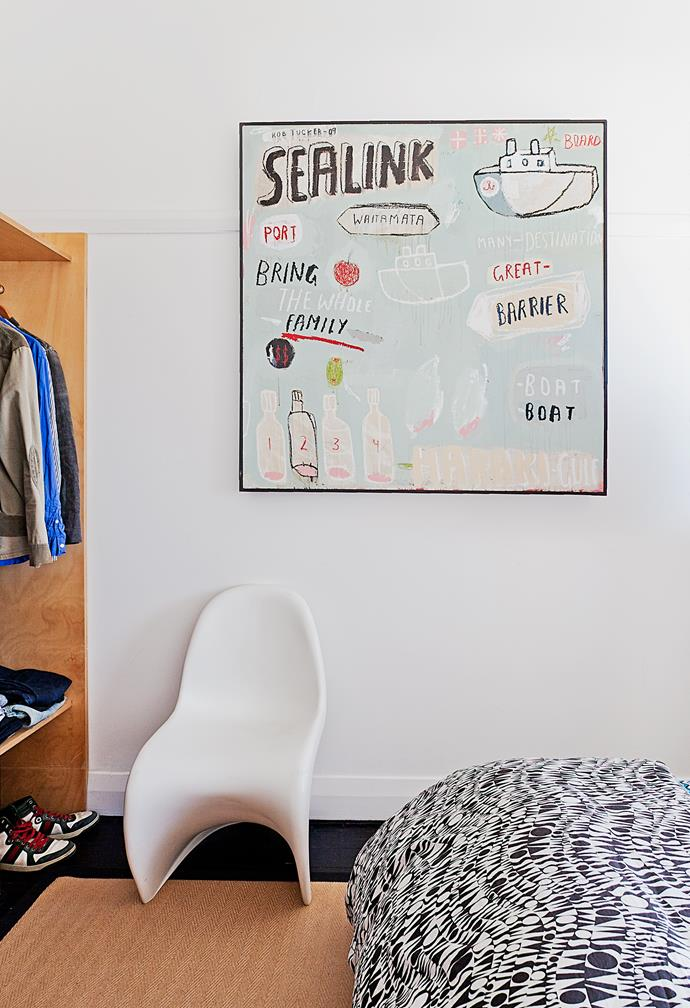 "Kelvin Ho also designed the open plywood cupboards in Sam's bedroom. ""I just needed space for shoes,"" Sam says. The artwork is by NZ artist [Rob Tucker](http://rob-tucker.com/?utm_campaign=supplier/