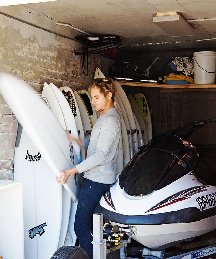 Sam stores his surfboard collection in the garage.