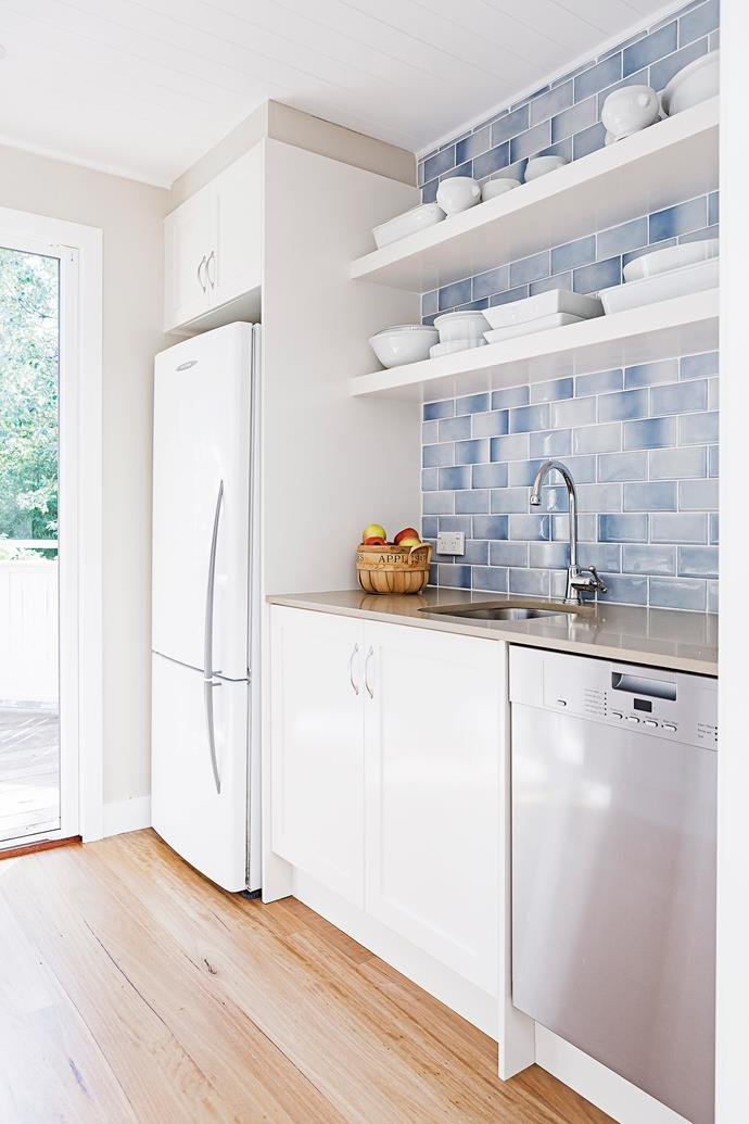 """""""As part of the renovation, we added a butler's pantry, and we love it. It opens out onto the deck and barbecue area, but it's such a versatile room. It's perfect for dumping the groceries, storing extra milk, displaying china and hiding the chocolate!"""""""