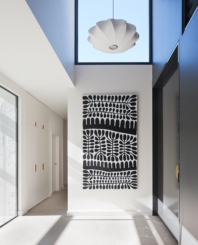 Artwork by Mitjili Napurrula in the entry.
