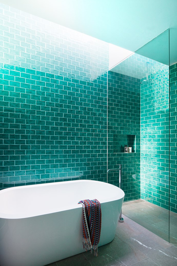 Teal tiles create a cool atmosphere in the bathroom.