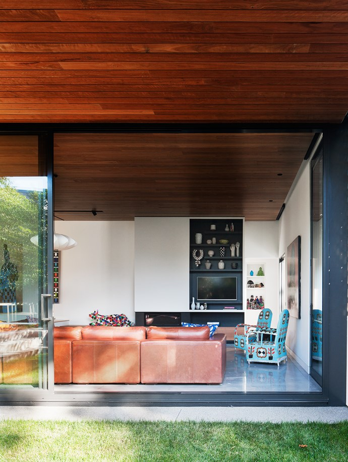 The blackbutt ceiling seamlessly extends through to the outdoor eaves.
