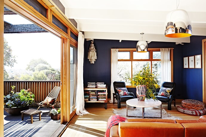 The relaxed but stylish lounge area spills out onto a sunny deck that overlooks the treetops.