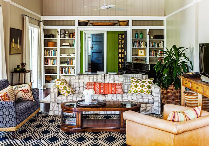 Layered collectables and interesting fabrics give the living room a casual feel.
