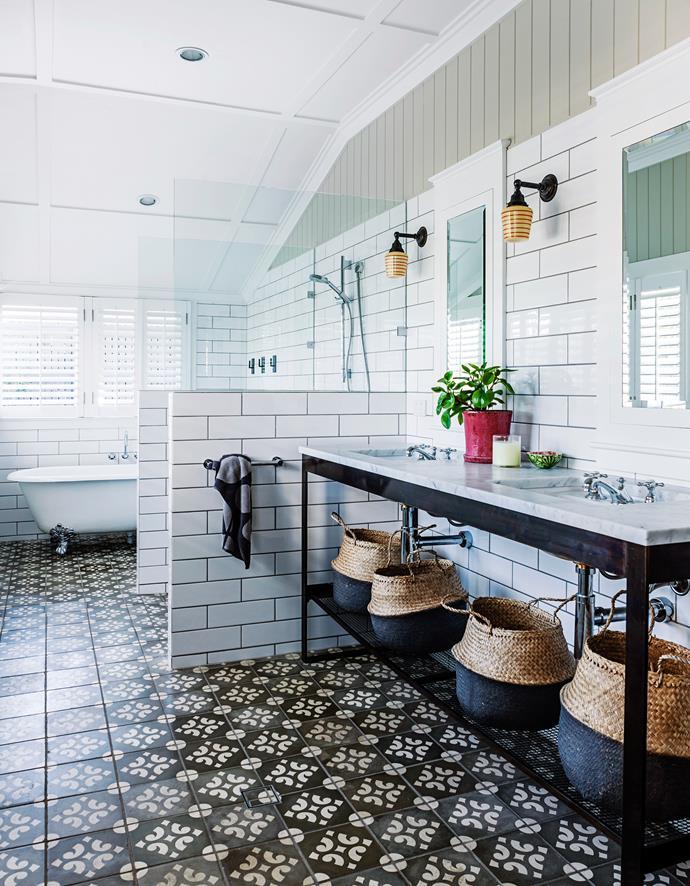 In the generous ensuite bathroom white subway tiles offset the intricate design of Spanish Villa antique floor tiles.