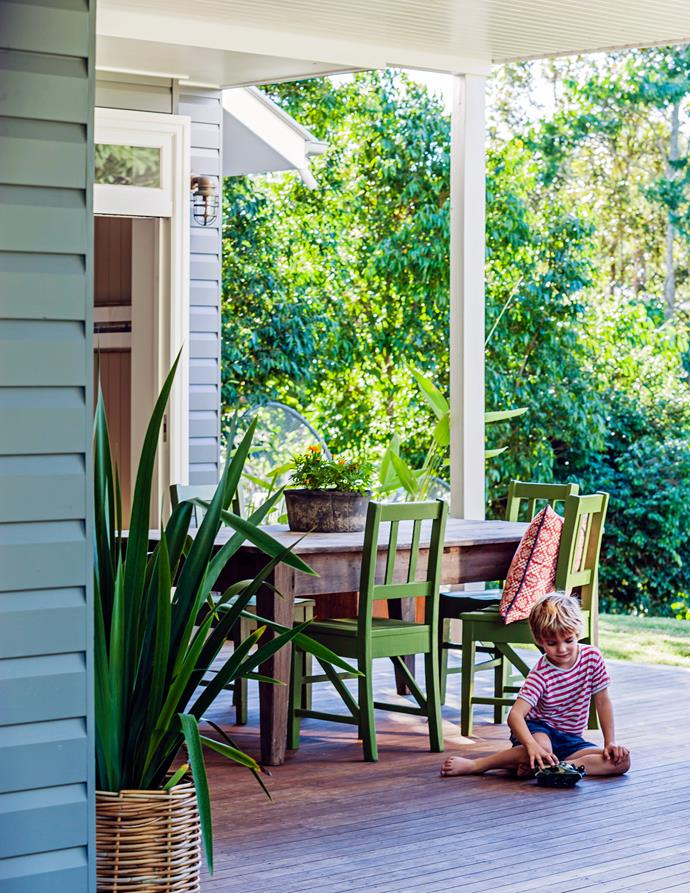 Connor, the youngest of the four boys, plays on the newly added tallowwood barbecue deck. Dining table and chairs were existing.