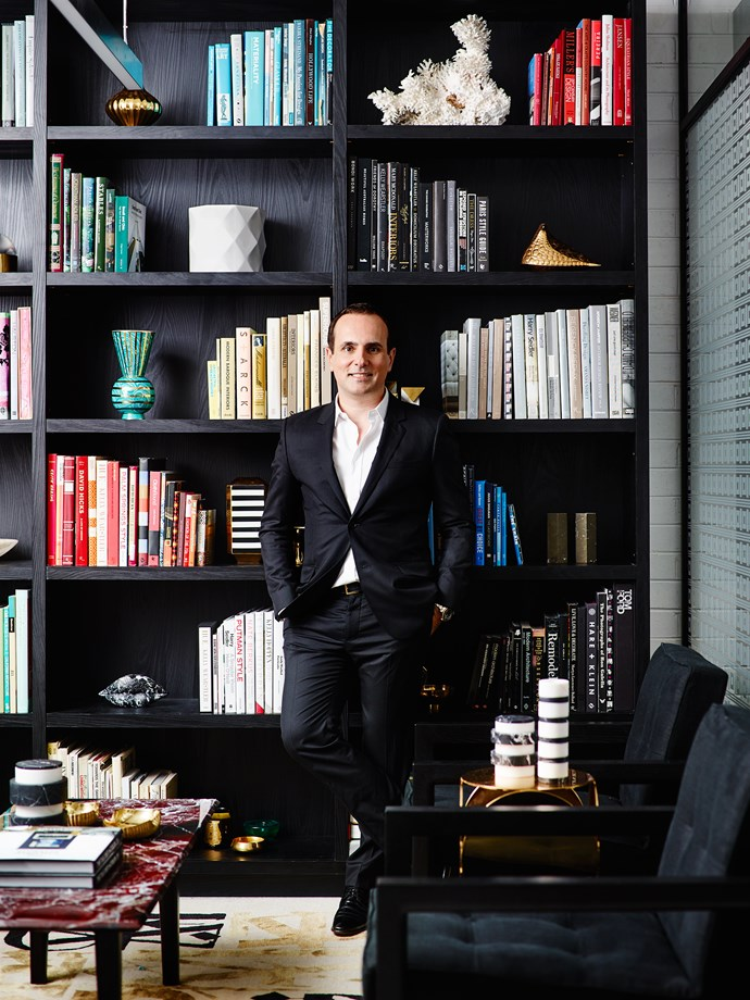 Greg Natale in his library - with colour coded bookshelves, of course. Photo: Anson Smart