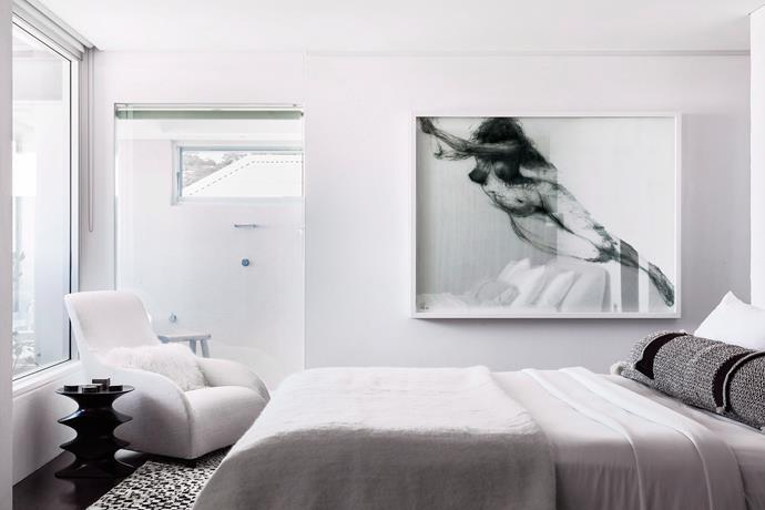 **Make the most of monochrome.** A pared-back colour palette is an easy way to give your room a cool, contemporary feel. It's super simple – and cheap. Paint walls white and go with muted grey tones when selecting furniture and finishings, throwing in the odd bit of black, too. Photo: Felix Forest / Bauersyndication.com.au.