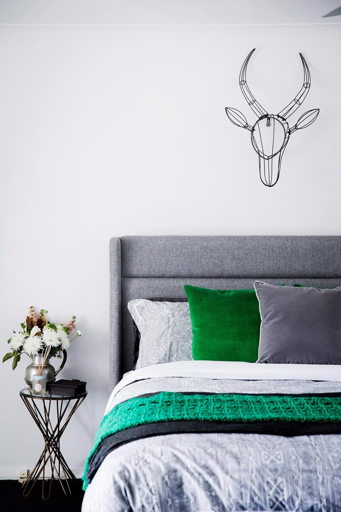 **Update a classic.** Rustic accessories can still find a place in your new contemporary bedroom if you modernise them a little. Take this metal deer head wall mount; teamed with a refined colour palette and minimalist furniture, the modern classic works wonderfully. Photo: James Henry / Bauersyndication.com.au.