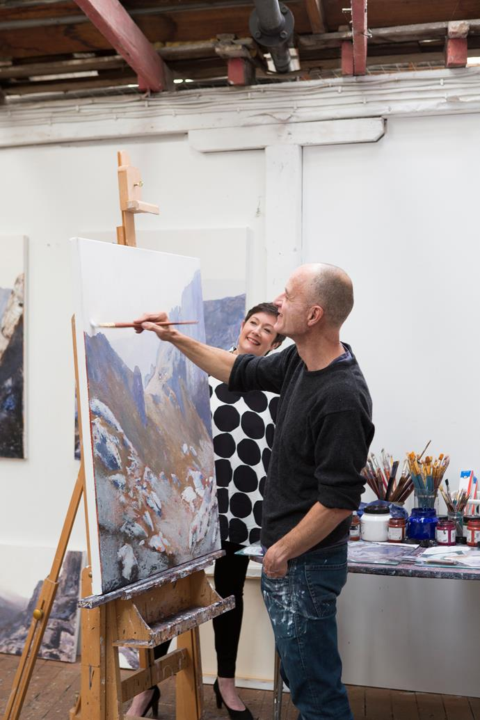 Allanah observes landscape painter Adrian Barber prepare works for his upcoming exhibition.