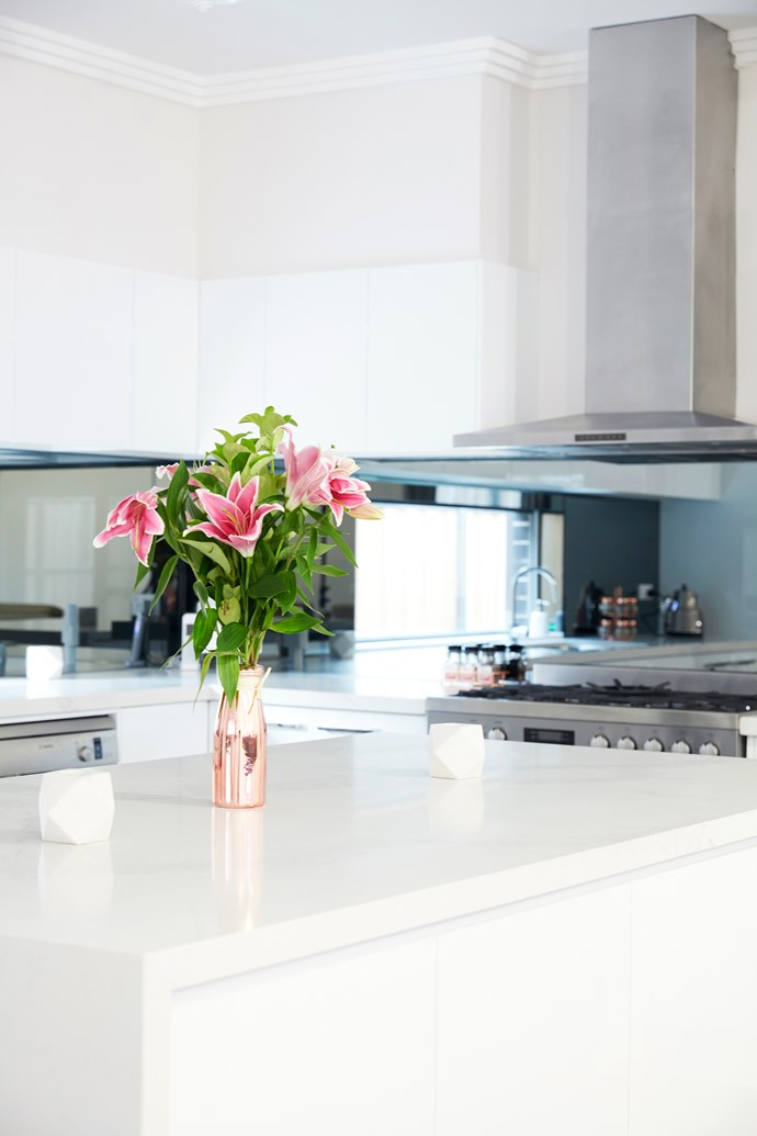 """""""We love the smoked glass and the quartz surfaces, and we're really happy we spent a bit more on them,"""" says Rena."""