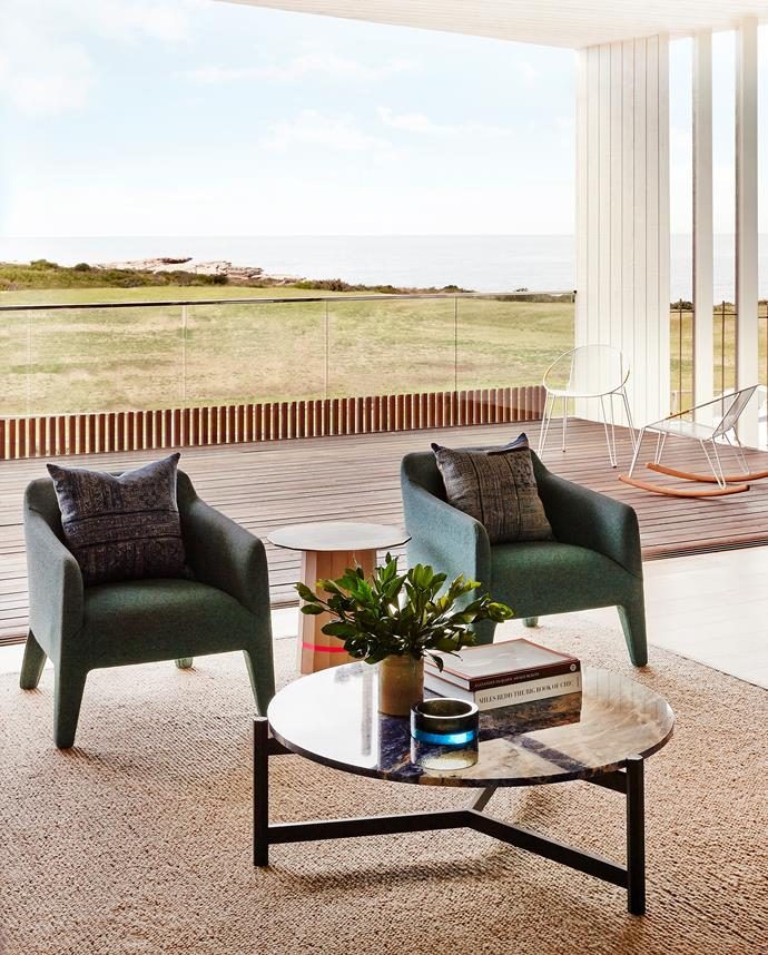 "The views dictated references to sea, sky and sandstone for the interiors. ""Because you're looking straight out onto ocean and cliffs you want it to feel seamless,"" says Brett, so the main colour is a sandy rather than stark white to connect to the surrounds."