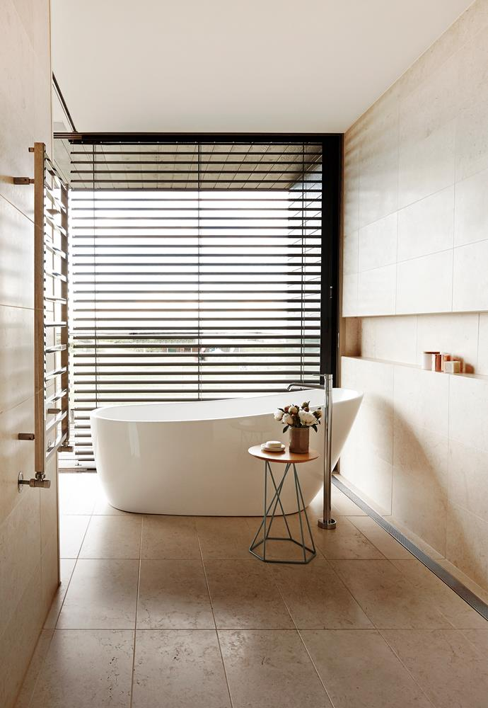 Natural surfaces with inherent irregularities were specified to soften the architecture's defined lines such as the limestone-lined bathrooms.