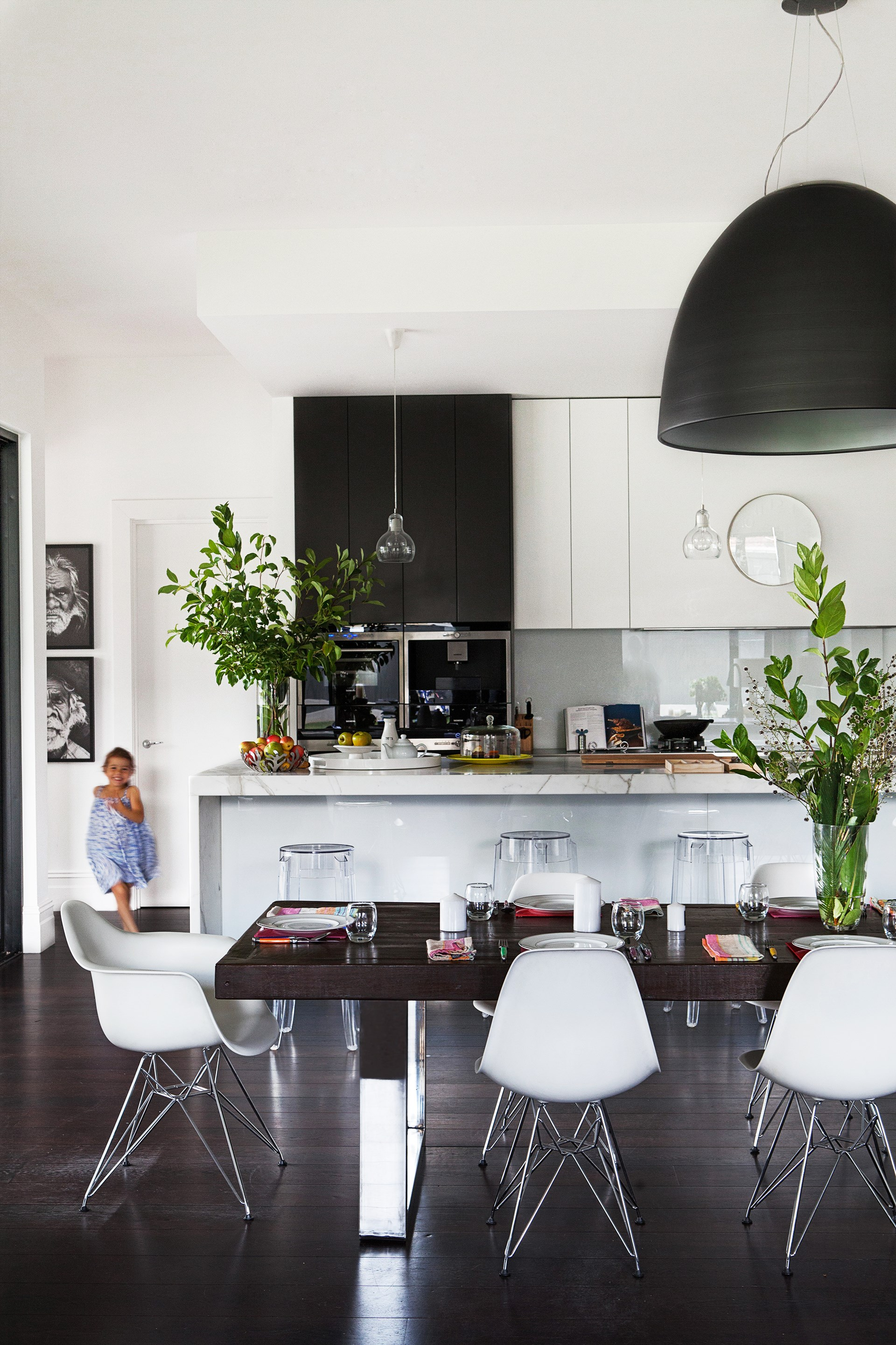 In this [Adelaide family home](http://www.homestolove.com.au/adelaide-family-home-renovation-3637) richly veined Calacatta marble is the perfect transition material to unite the kitchen's contrasting colour scheme. *Photo: James Knowler*