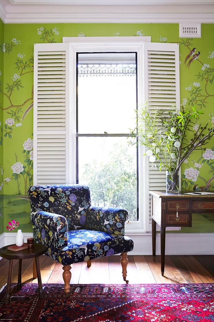 The formal lounge, or 'green room' as the family refers to it, features an imported hand-painted silk wallpaper that was custom-dyed to their preferred shade.