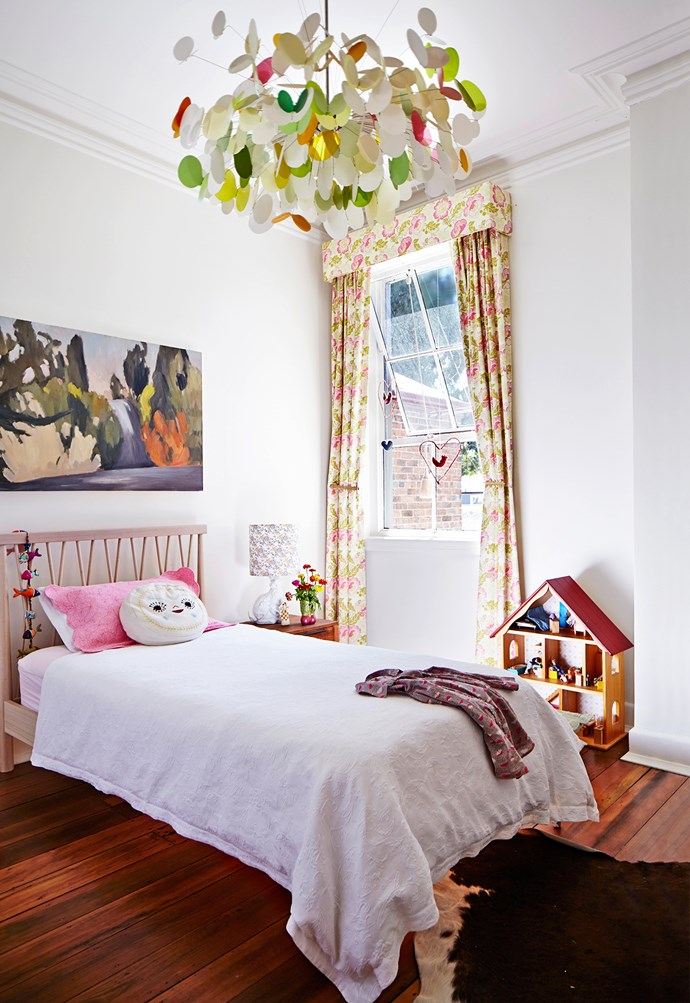 "White walls provide a perfect canvas for pretty artworks and floral curtains. ""We love to acquire new art and will always make space for another drawing, painting or etching,"" says Belinda"