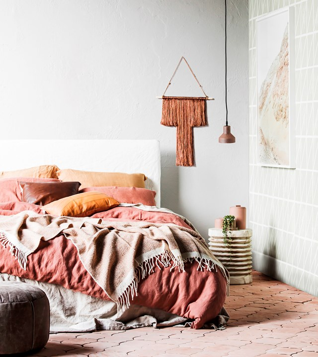 Layers of burnt-earth tones and cosy textures complement each other this inviting boho bedroom. Balance warm colours with contrasting neutrals or greys for a serene feel. [> Find out more about styling a home harmoniously with tonal colours.](http://www.homestolove.com.au/how-to-style-a-harmonious-home-with-tonal-colours-3651) Photo: Maree Homer / real living