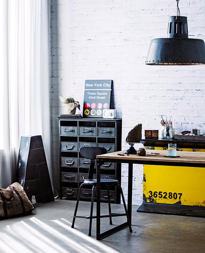 Repurposed vintage industrial metal multi-drawer cabinets are great for filing.