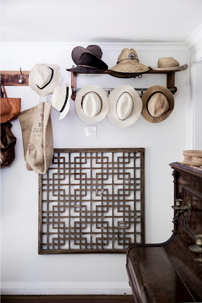 """A piano from eBay, pre-loved Asian screen and antique hat rack create a charming corner in this [quintessential beach cottage](http://www.homestolove.com.au/a-seamless-cottage-renovation-by-the-sea-3543