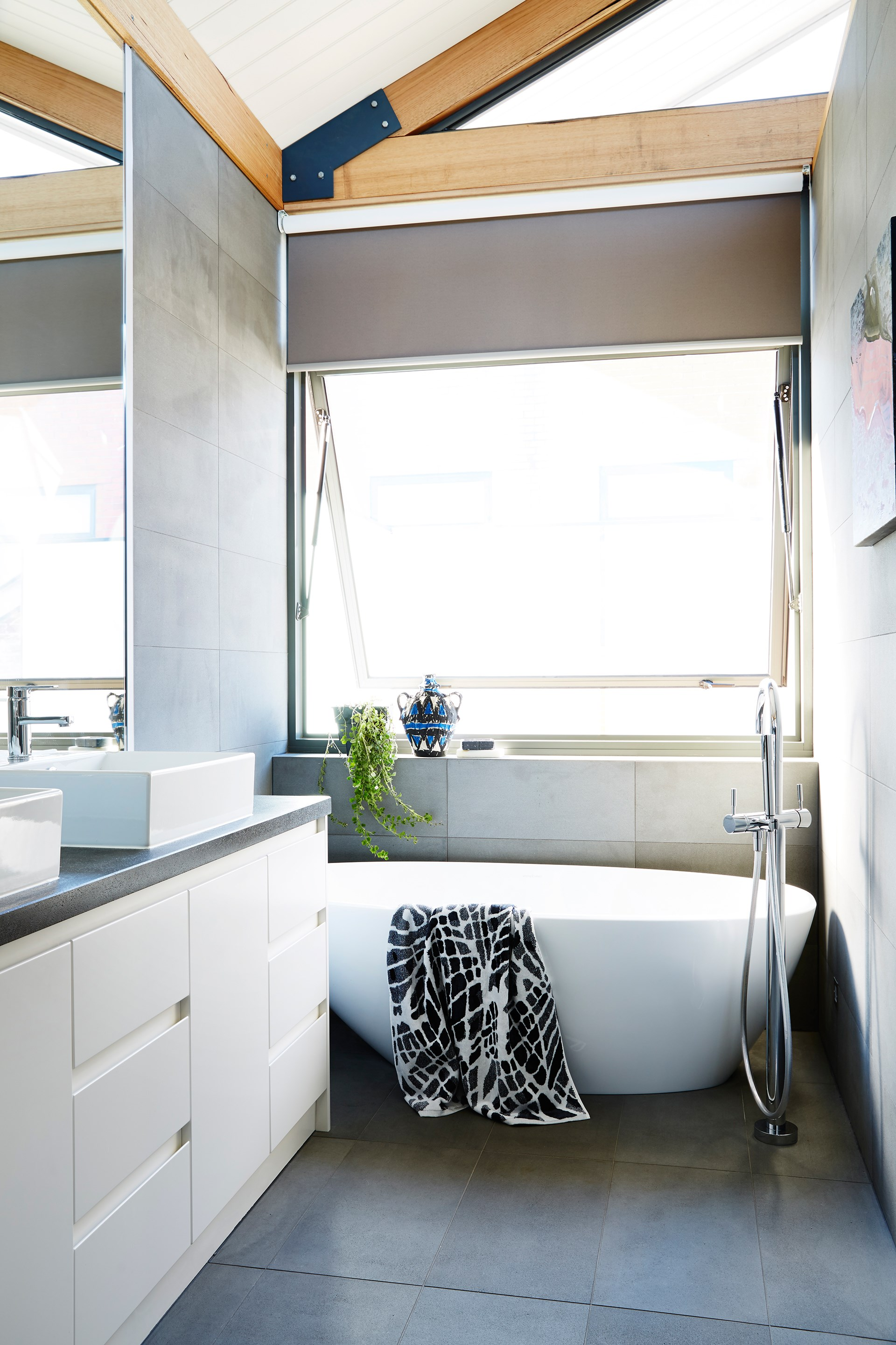 """Large bluestone tiles add a contemporary yet earthy edge to the bathroom in this [Melbourne warehouse conversion](http://www.homestolove.com.au/cosying-up-a-melbourne-warehouse-conversion-3653