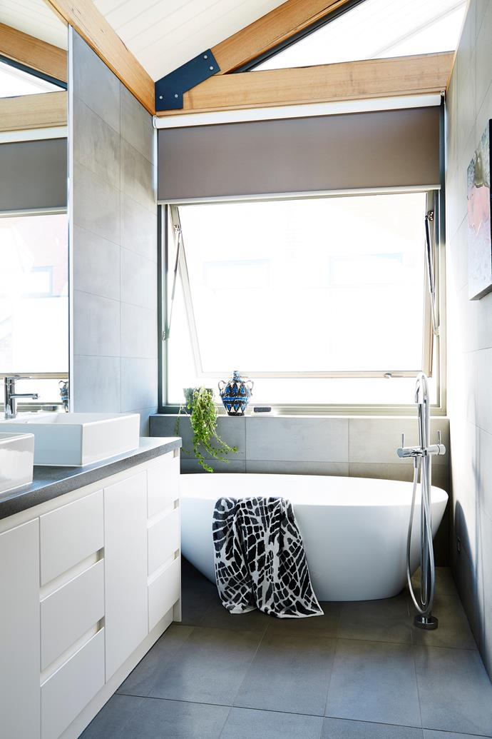 Colour is subdued in the bathroom with white and grey taking centre stage.