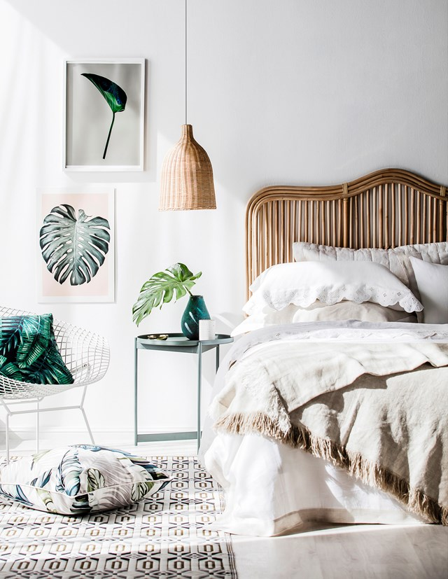 **Neutral ground:** Natural materials and green accents combine for a fresh, on-trend bedroom. The addition of palm leaves introduces a holiday-at-home vibe. *Photo:* Maree Homer