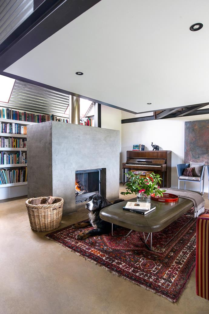 """The cosy open-plan living area, heated by a freestanding [Cheminées](http://www.cheminee.com.au/?utm_campaign=supplier/