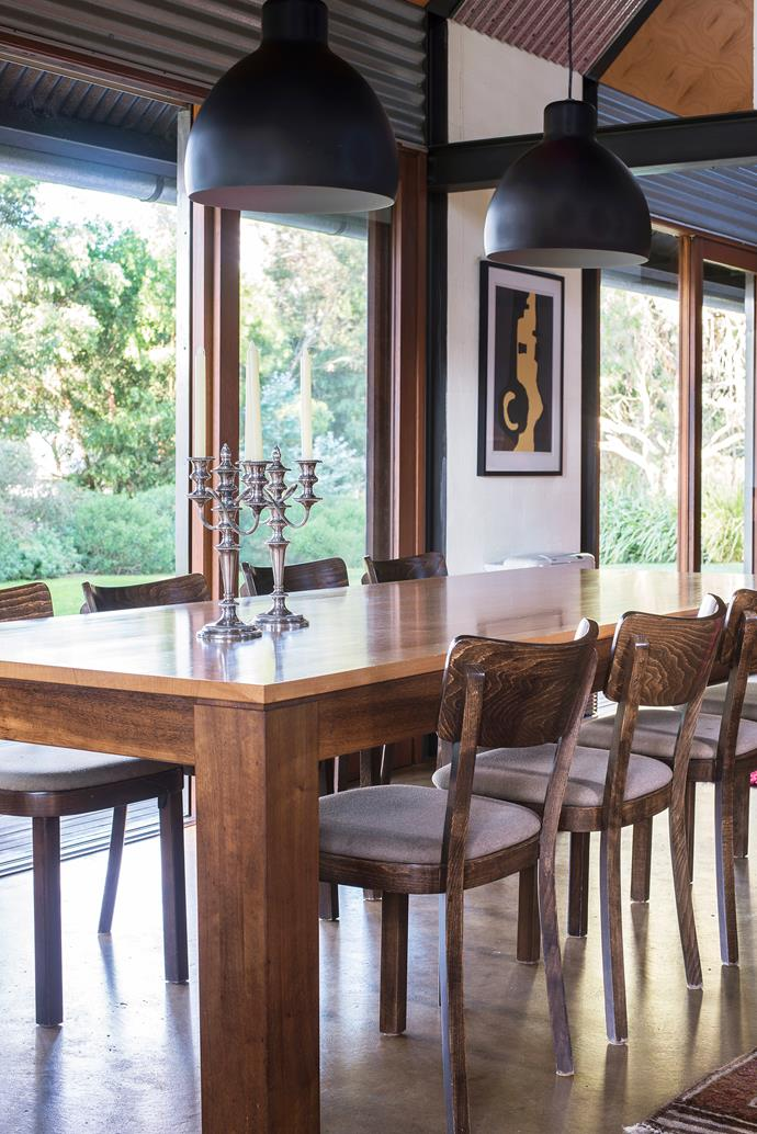 The table in the dining area was designed by David, while the antique Hardy Brothers candlesticks are a treasured family heirloom.